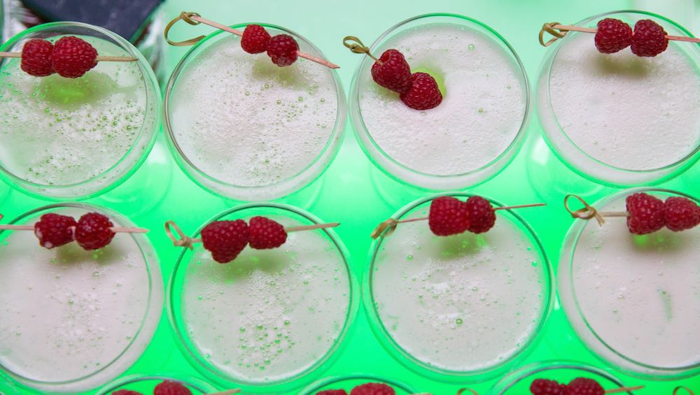 THE GLOSS 10th Birthday Cocktail, made with Ketel One French Martini, Chambord, fresh pineapple, lemon and raspberries